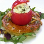 Open tomato tart stuffed with ricotta and pine nuts